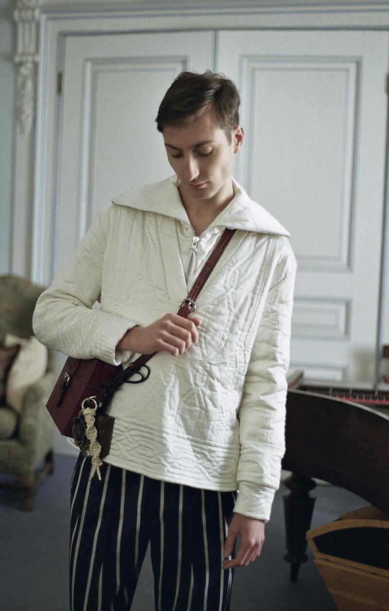 menswear concept over shoulder bag
