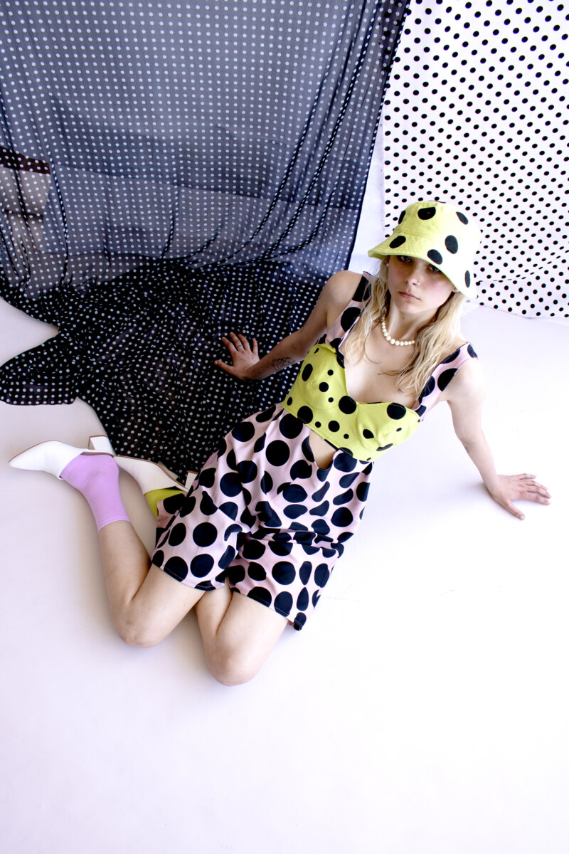 model in spotted 60's dress