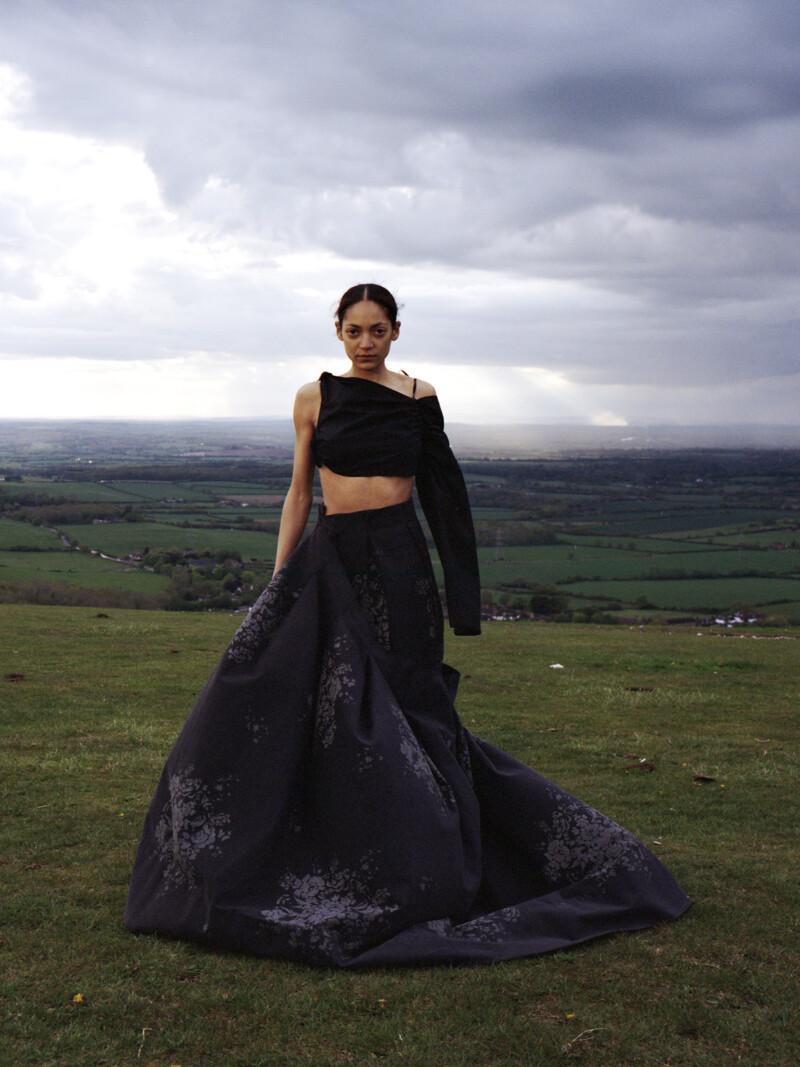 woman wearing black concept dress in a field