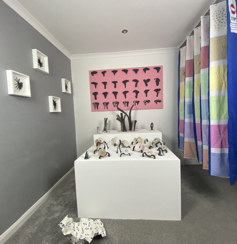 Collection of ceramic and embroidery work about menstruation