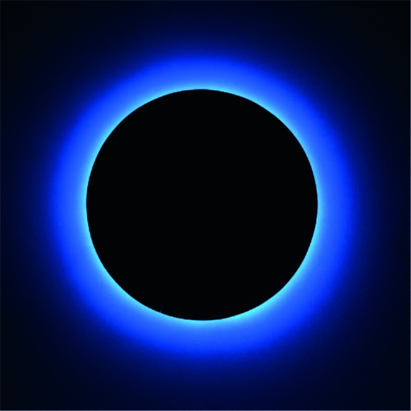 black circle with blue light glow around it