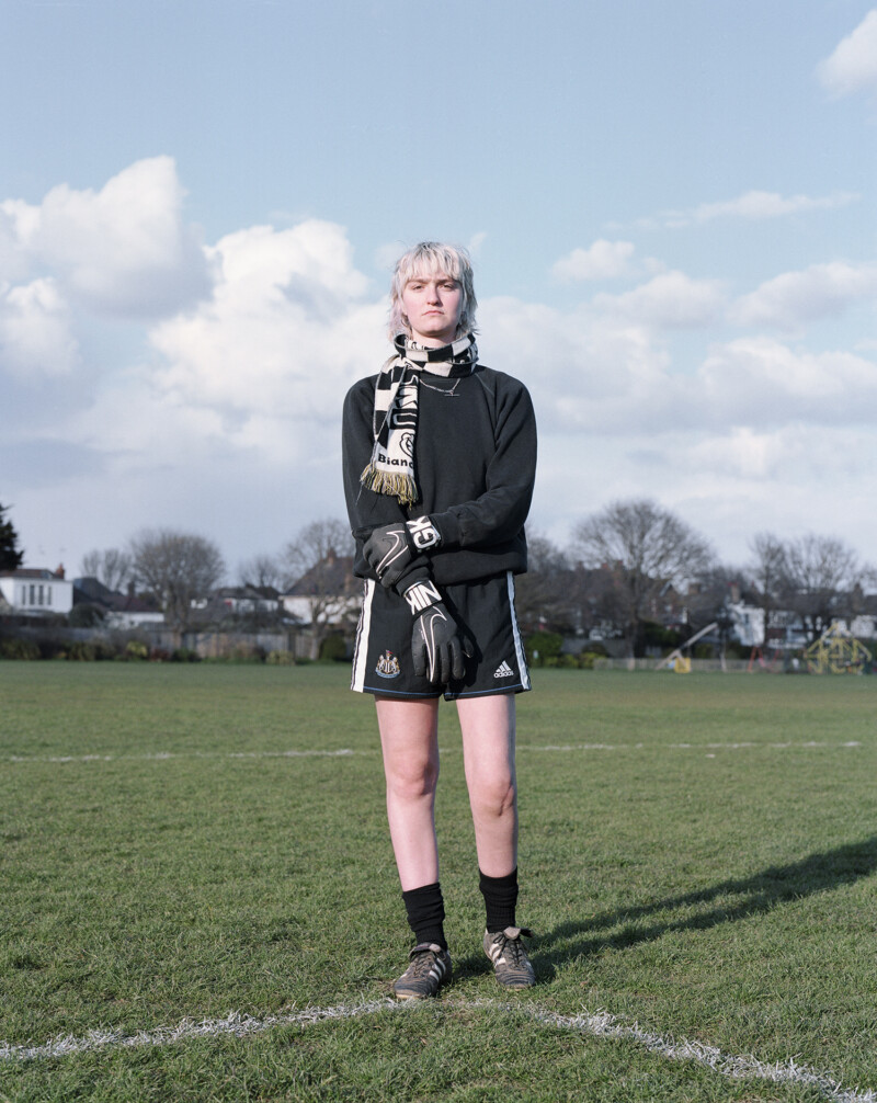 person wearing black football top and shorts