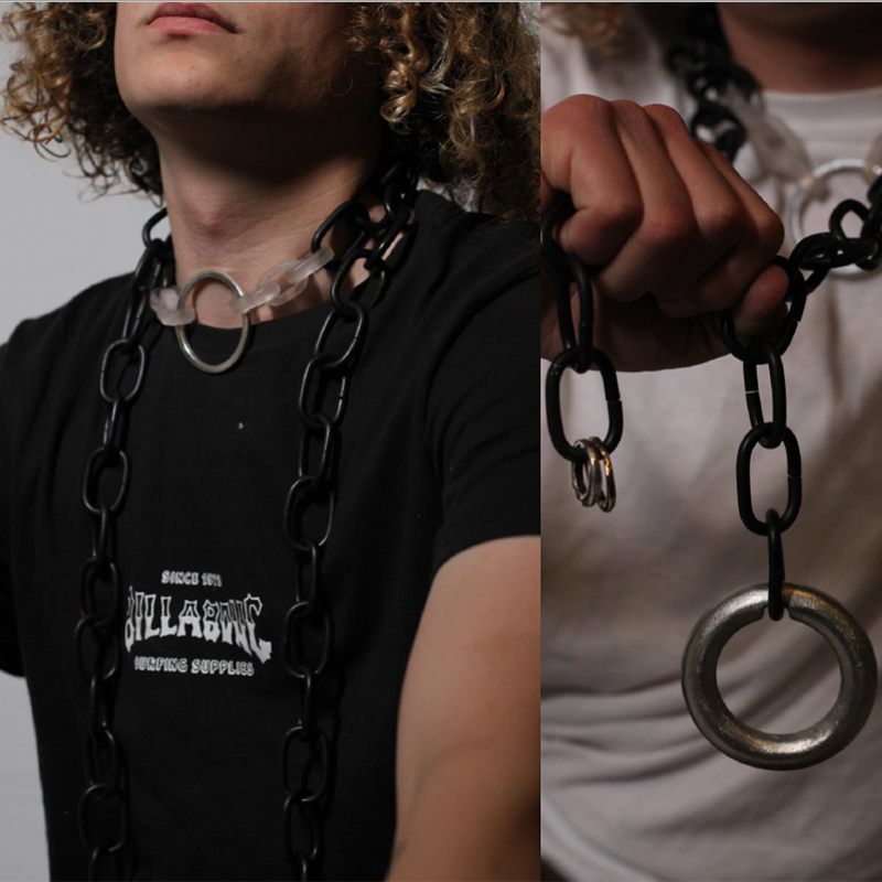 person wearing chains with plastic and silver links