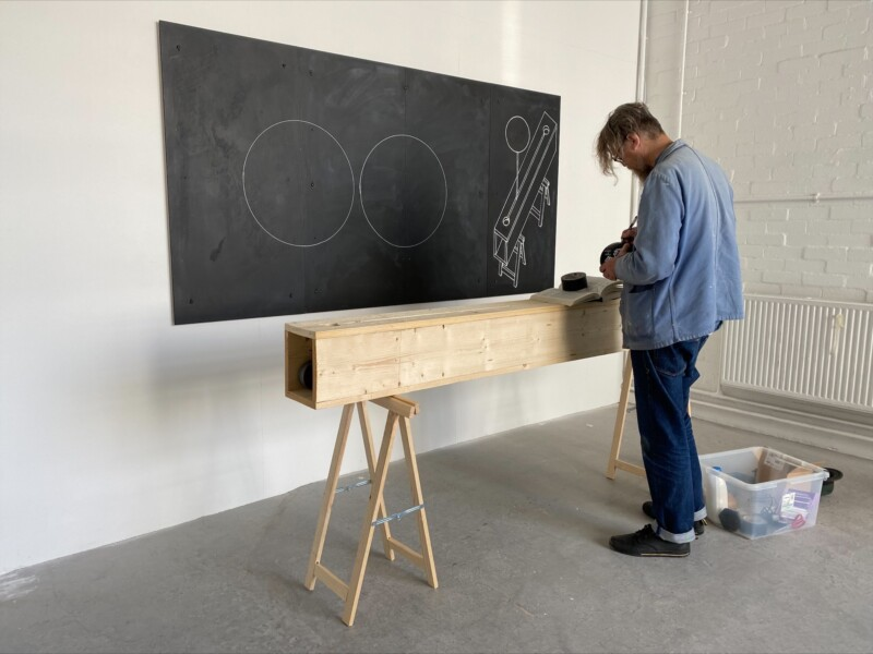 person standing in front of blackboard