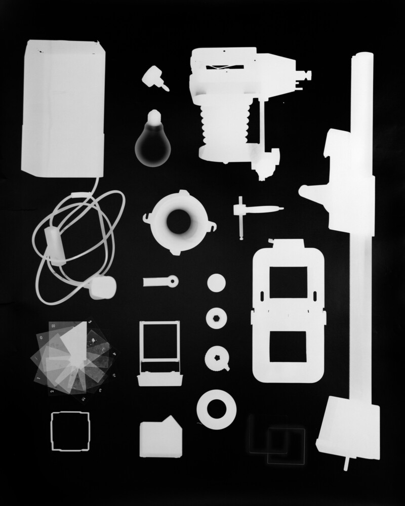 Photogram image of different parts of a photographic enlarger