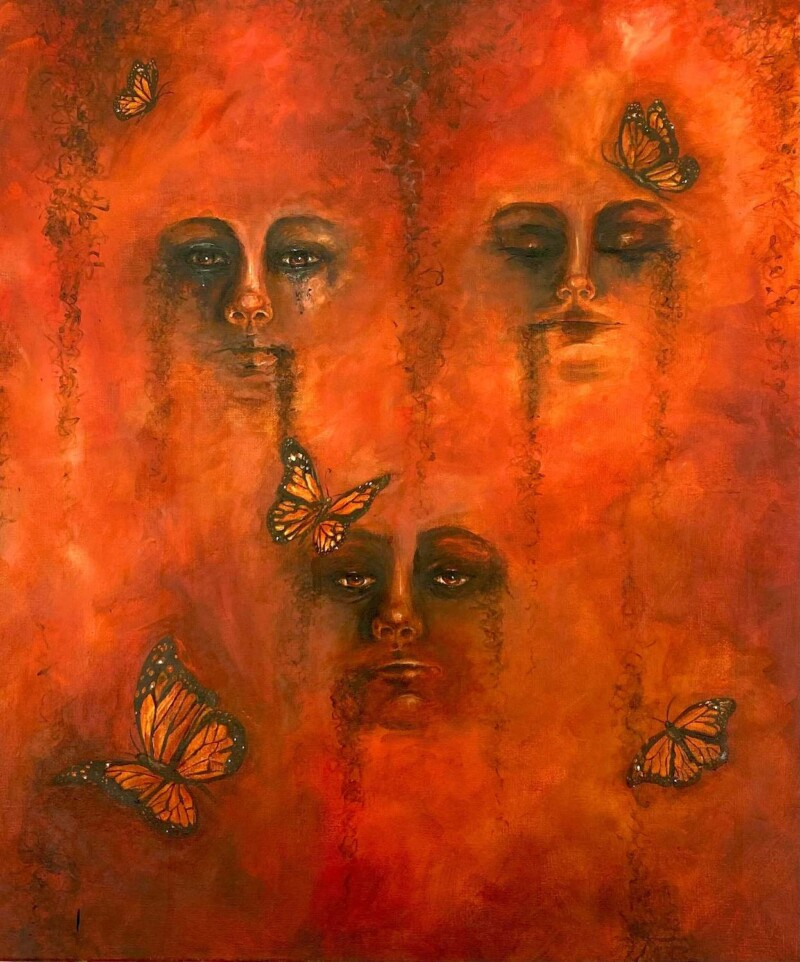 painted facial features in orange with butterfly's
