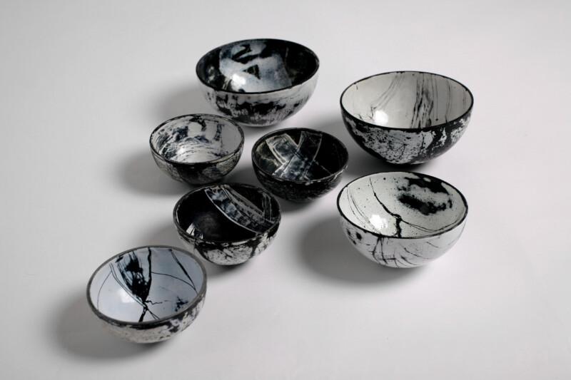white and black enamelled bowls