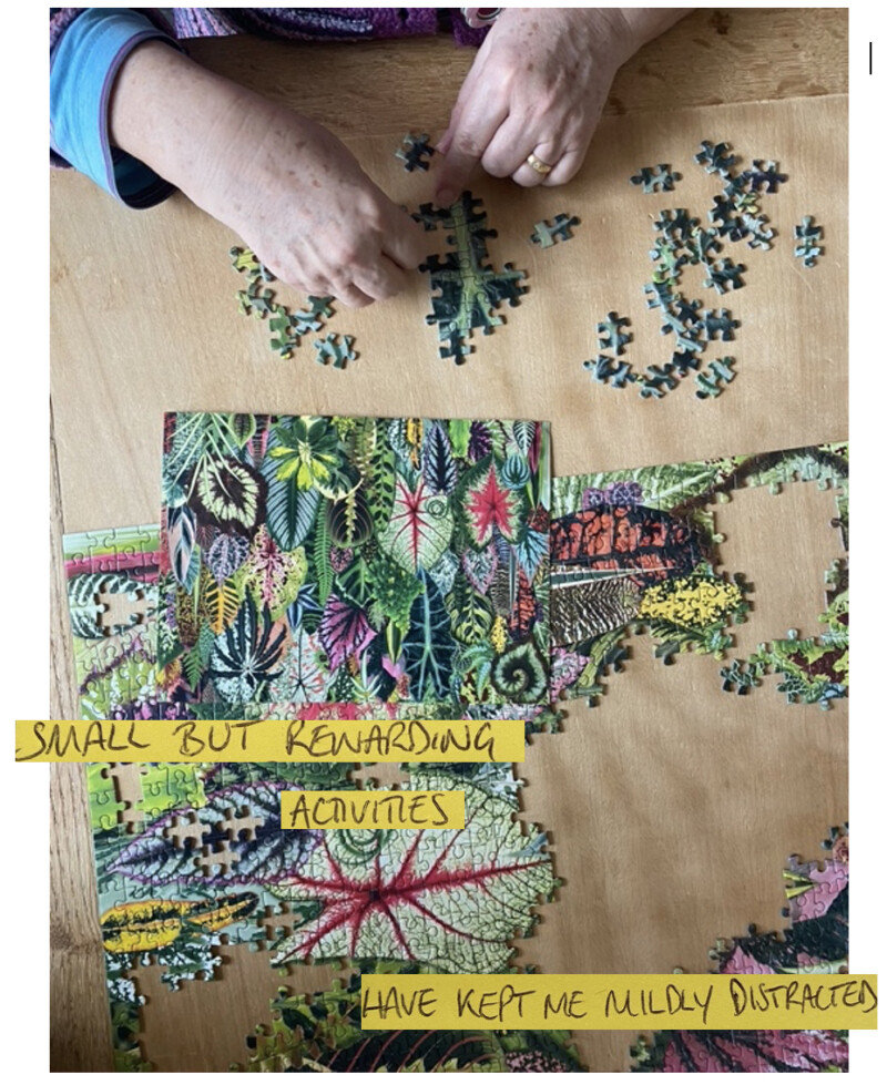 person completing jigsaw puzzle
