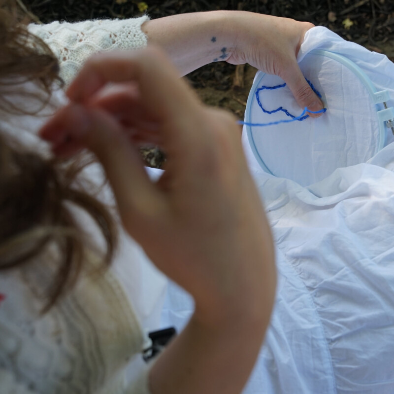 closeup of person embroidering