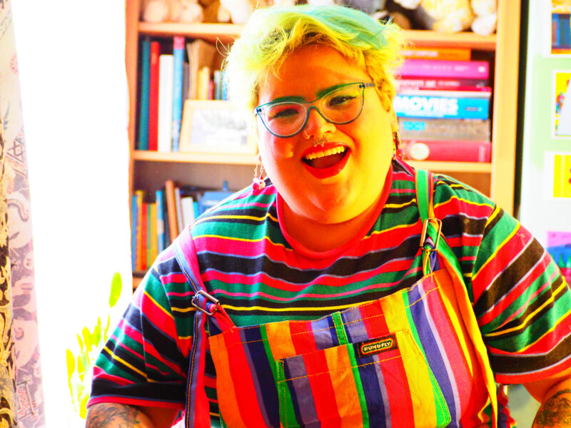 person wearing multicoloured clothing in multicolour tone